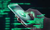 Mobile phone personal data and cyber security threat concept. Cellphone fraud. Smartphone hacked with illegal spyware, ransomware or trojan software. Hacker doing online scam.