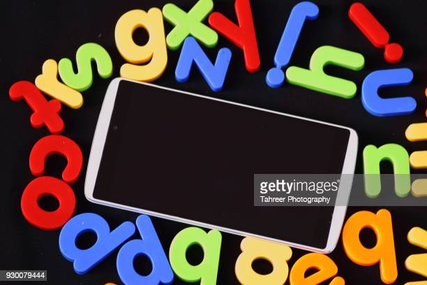 Mobile phone placed among alphabet blocks