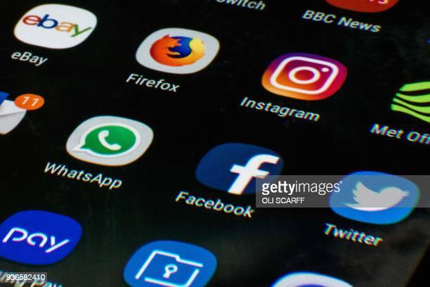 A mobile phone screen displays the icons for the social networking apps Facebook Twitter and Instagram taken in Manchester England on March 22 2018 A...
