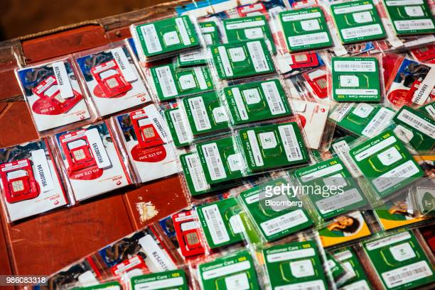 Mobile phone SIM cards sit for sale at a roadside mobile phone airtime stall in Lilongwe Malawi on Tuesday June 26 2018 Local currency the Malawian...