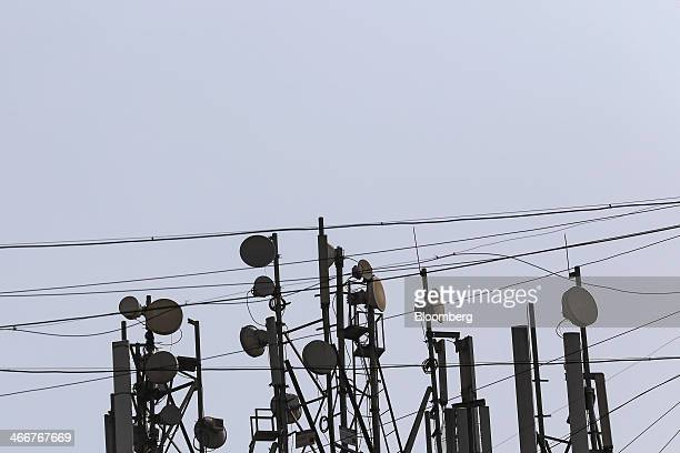 Mobile phone telecommunications towers stand in Mumbai India on Wednesday Jan 29 2014 India got bids totaling 4461 billion rupees on the first day of...