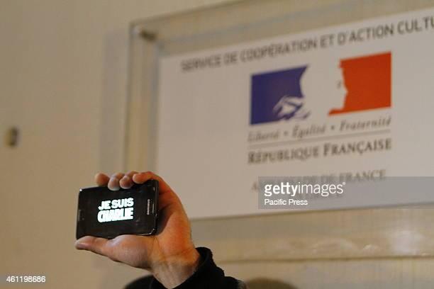 GRèCE ATHENS ATTICA GREECE A mobile phone that shows 'Je suis Charlie' is hold up at the vigil outside the Institut Français de Grèce A vigil in...