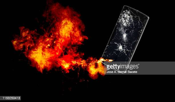 mobile phone with broken glass exploding. - smoking crack stock photos and pictures