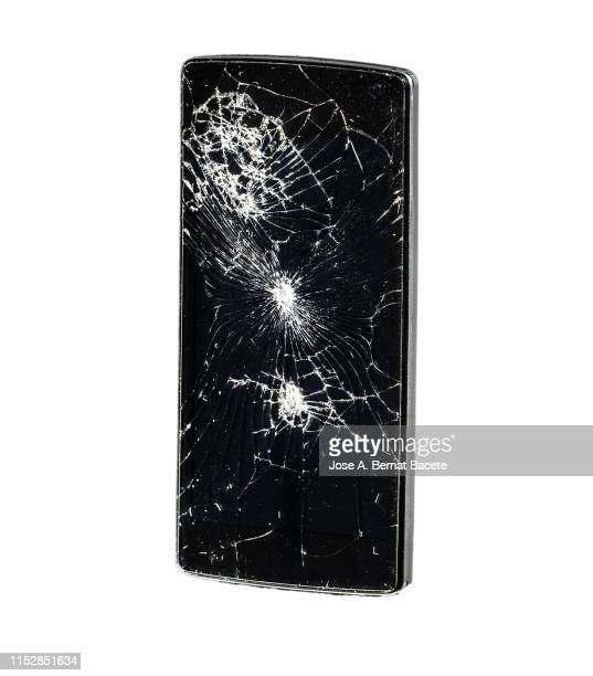 mobile phone with broken glass on a white background. - broken stock pictures, royalty-free photos & images