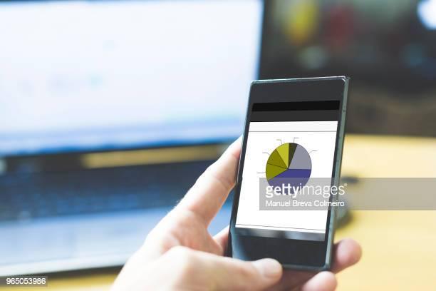 mobile phone with data - data stream - fotografias e filmes do acervo