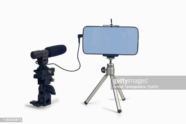 mobile phone with microphone against white background - tripod stock pictures, royalty-free photos & images