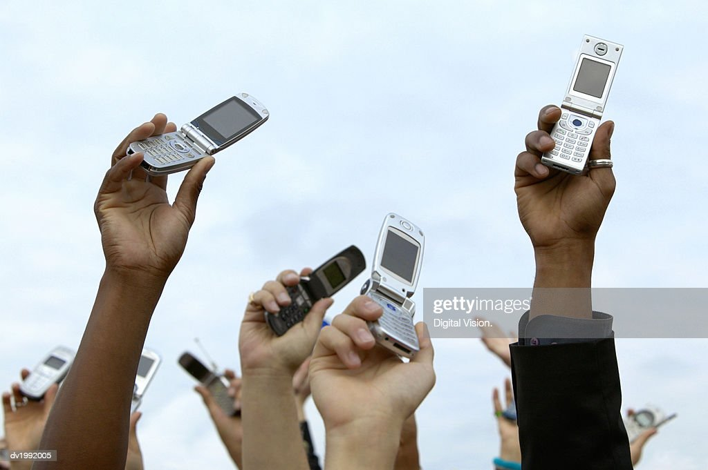 Mobile Phones Being Held in the Air : Stock Photo