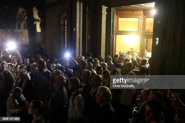 Mobile phones flash as crowds gather outside Escola Industrial of Barcelona school in protest and defence of the polling station from police to be...
