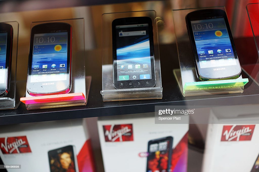 Mobile phones sit on display in the window of a store on January 14, 2013 in New York City. Responding to weaker than expected demand, Apple has cut orders for LCD screens and other parts for the iPhone 5 this quarter. Shares for the tech company fell more than 4 percent to $498.20 before the bell on Monday. Analysts see the slowing sales as evidence that the U.S. firm is losing ground to Asian smartphone rivals.