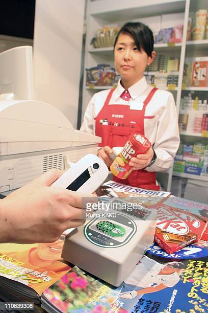 Mobile Phones To Be Used As Train Tickets Commuter Passes Prepaid Cards In Tokyo Japan On February 22 2005 A model demonstrates payment with NTT...