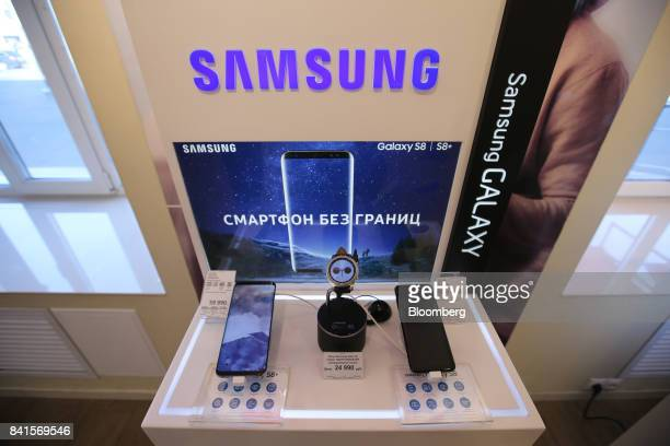 Mobile technology including the Galaxy S8 and S8 smartphones and Samsung Gear S3 smartwatch sit on a display of Samsung Electronics Co products...