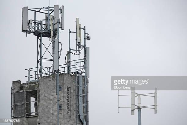 A mobile telephone mast left hangs from a tower in London UK on Monday Oct 8 2012 Deutsche Telekom AG and France Telecom SA's UK mobilephone venture...