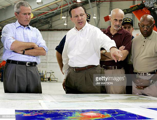 Mobile, UNITED STATES: Photo dated 02 September 2005 shows US President George W. Bush and Homeland Security Secretary Michael Chertoff getting a...