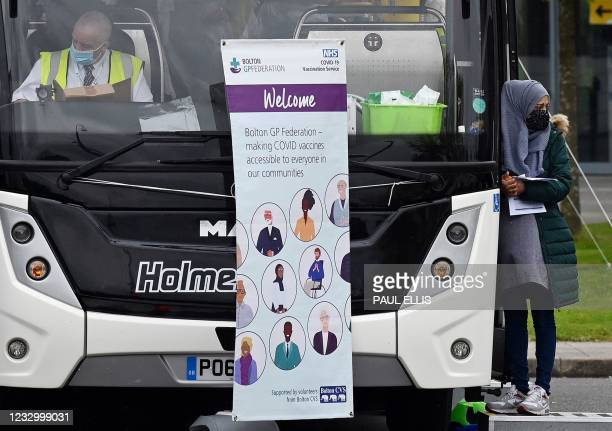Mobile vaccination bus is seen parked at a temporary vaccination centre at the Essa academy in Bolton, northwest England on May 20, 2021.