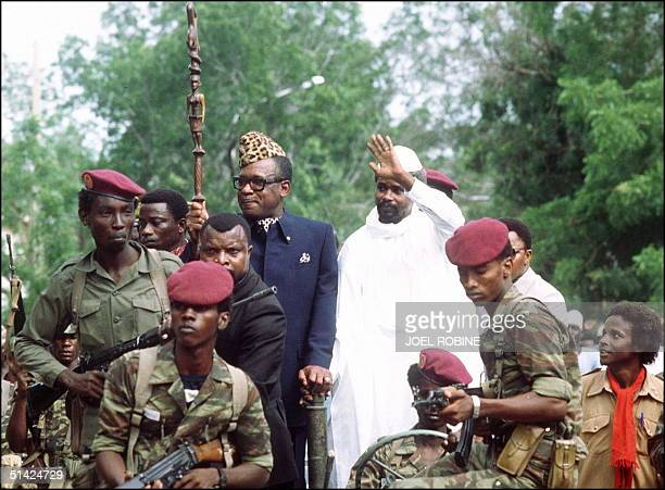 Mobutu Sese Seko, president of Zaire , and Hissene HabrT, president of Chad, wave to wellwishers, 20 August 1983, upon Mobutu's arrival to N'djamena.