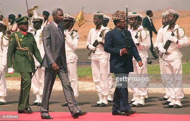 Mobutu Sese Seko the President of Zaire and Abdou Diouf the President of Senegal review troops 26 May 1989 upon Mobutu's arrival for the Francophone...
