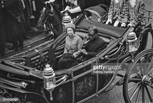 Mobutu Sese Seko , the President of Zaire, in a carriage with Queen Elizabeth II during an official visit to London, UK, 11th December 1973.