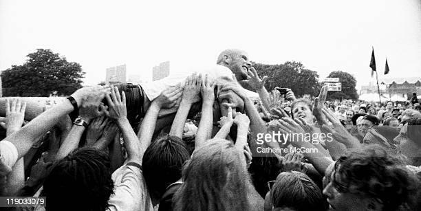Moby crowd surfing during a performance at Lollapalooza in August 1995 in New York City New York