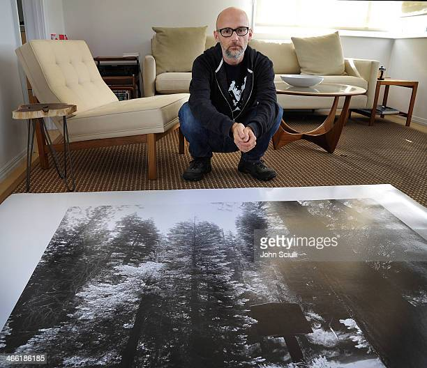 "Moby is seen with his own work titled ""first"" during Art Los Angeles Contemporary private collection tour on January 31 2014 in Los Angeles..."