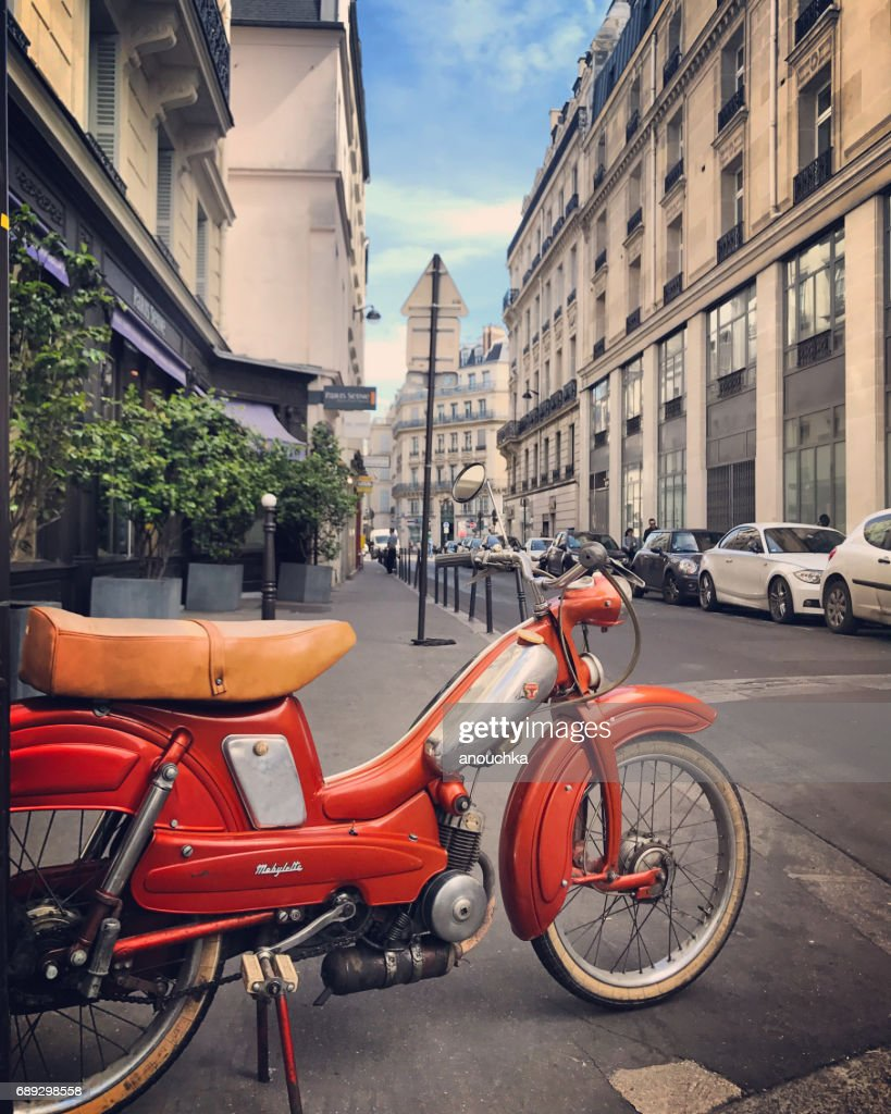 Mobylette, 70s French moped parked on Paris street, France : Stock Photo