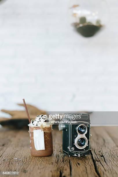 Mocha cafe in the beaker and vintage film camera