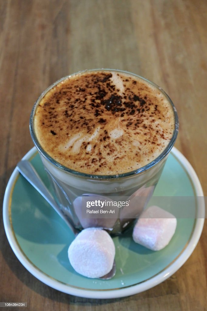 Mochachino Coffee Drink Served on a Wooden Table in a Cafe Restaurant : Stock Photo
