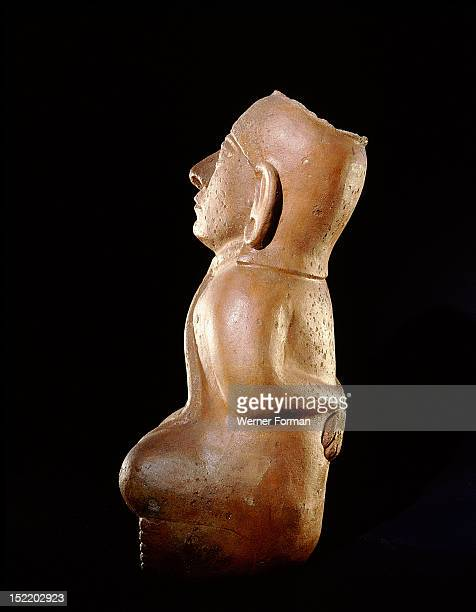 Mochica vessel in the form of a seated prisoner with his hands bound behind his back A second rope is attached to both his neck and his penis This...