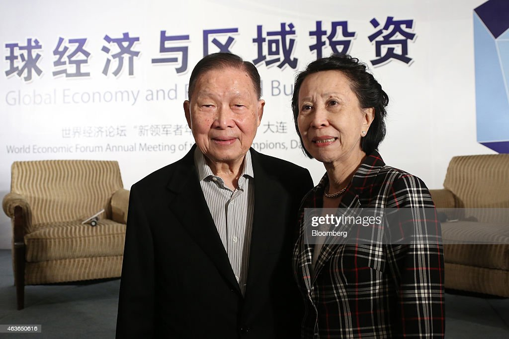 Mochtar Riady, chairman of Lippo Group, left, poses for a photograph with his wife Suryawati Lidya following the Caixin Breakfast Dialogue on the sidelines of the World Economic Forum Annual Meeting Of The New Champions in Dalian, China, on Friday, Sept. 13, 2013. The forum, also known as 'Summer Davos', concludes today. Photographer: Tomohiro Ohsumi/Bloomberg via Getty Images