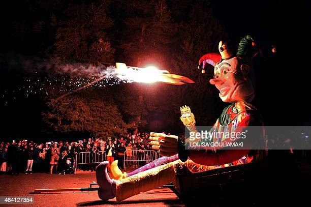 A mock burning plane flies to set a character representing the King of Carnival on fire on February 22 2015 during the carnival celebrations in the...