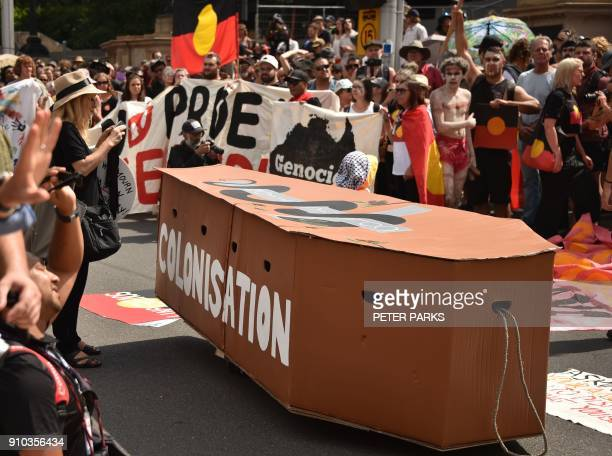 A mock coffin is displayed during an 'Invasion Day' rally on Australia Day in Melbourne on January 26 2018 Thousands of supporters joined rallies...