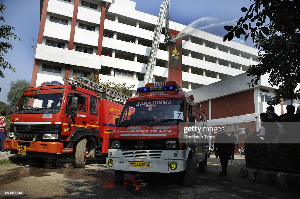 A Mock earthquake rescue drill, at Mini Secretariat, on February 7, 2013 in Gurgaon, India. Mock drill organized by Gurgaon Disaster Management Authority (GDMA) and the National Disaster Management Authority (NDMA) at many places in city to check the preparedness of officials and citizens to tackle natural calamities.