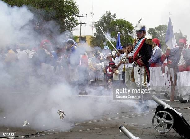 A mock French Army fires small cannons during a reenactment of the 1862 battle between the French and the Zacapuaxtlas Indians as Mexicans celebrate...