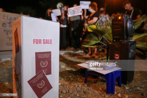 Mock passports for sale stand is seen during an anti-corruption protest on October 14, 2020 in Nicosia, Cyprus. Cyprus has cancelled its citizenship...