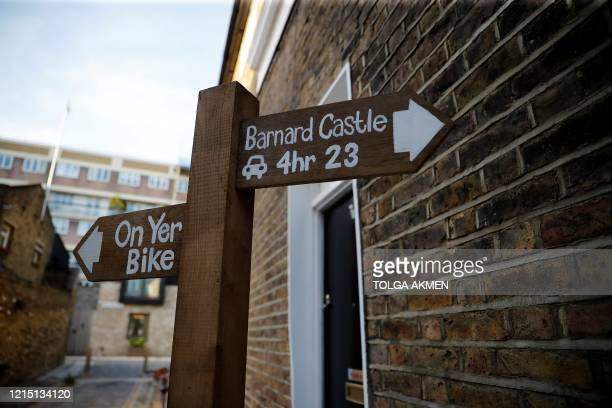 A mock signpost giving directions to Barnard Castle southwest of Durham is pictured near to the home of 10 Downing Street special advisor Dominic...