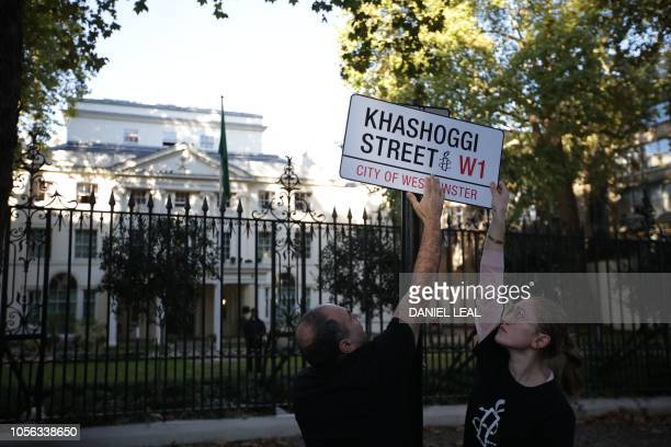 A mock street sign reading 'Khashoggi Street' is erected by Amnesty International activists on the street in front of the Embassy of Saudi Arabia in...