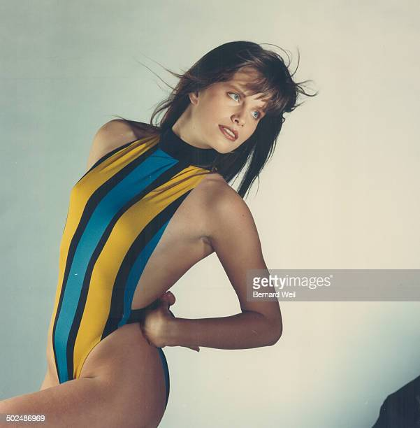 Mock turtleneck Front view of Yves Saint Laurent's striped Lattice maillot of nylon or spandex $70 at The Prospect of Redpath also shown on Fashion...