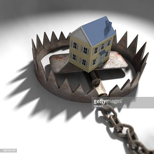mock up of a house in a trap, symbolizing mortgage pressure - booby trap stock pictures, royalty-free photos & images