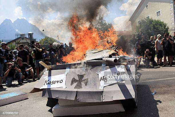A mock up of a tank burns during an anti G7 demonstration in front of the Marshall Center on June 5 2015 in GarmischPartenkirchen Germany G7 leaders...