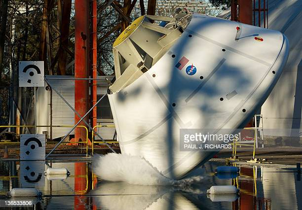 A mock up of the 18000pound Orion deep space exporation vehicle flys at a high impact pitch of 43degrees and enters the water after being lifted high...