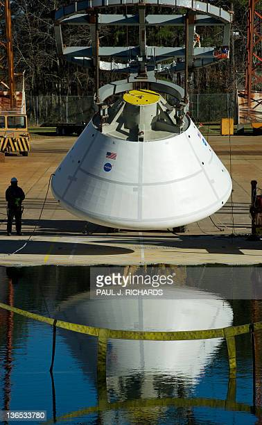 A mock up of the 18000pound Orion deep space exporation vehicle is lifted at a high impact pitch of 43degrees and lifted high enough on the gantry to...