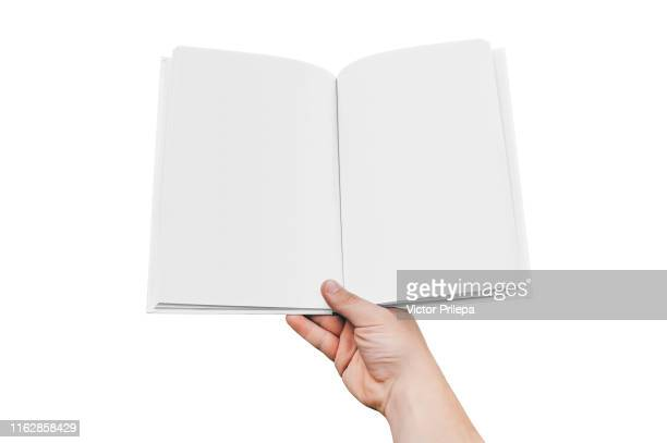 mock up of the book isolate in hand man closeup, on a white background. concept on the topic of education - back to school. - blank magazine ad stock pictures, royalty-free photos & images