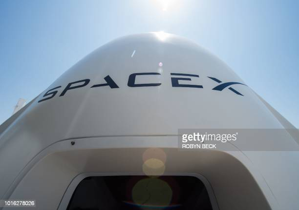 A mock up of the Crew Dragon spacecraft is displayed during a media tour of SpaceX headquarters and rocket factory on August 13 2018 in Hawthorne...