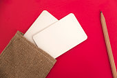 http://www.istockphoto.com/photo/mock-up-of-white-paper-business-cards-in-linen-bag-on-red-background-gm843935858-138002363