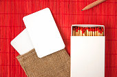http://www.istockphoto.com/photo/mock-up-of-white-paper-cards-in-linen-bag-and-matchbox-on-red-background-gm843522304-137863721