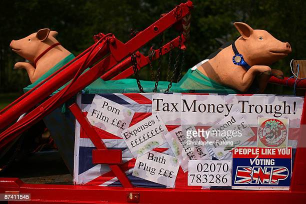 Mock up pigs in a trough, driven by British National Party campaigners, drives past the home of Labour minister Hazel Blears as BNP candidate Gary...