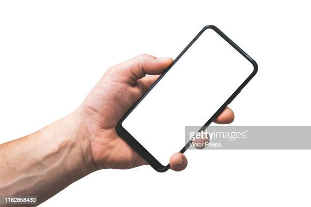 mock up smartphone isolate in hand man - closeup, on a white background. - menselijke hand stockfoto's en -beelden