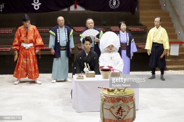A mock wedding ceremony is held on Dec 2 at a sumo museum in Katsuragi a western Japan city considered the birthplace of sumo due to a reference in...