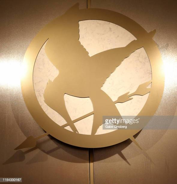 """Mockingjay emblem from the """"Hunger Games"""" movie franchise is displayed The Hunger Games: The Exhibition grand opening at MGM Grand Hotel & Casino on..."""