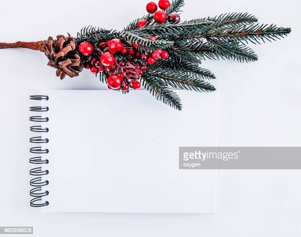 Mockup notepad with Christmas  pine tree on white background