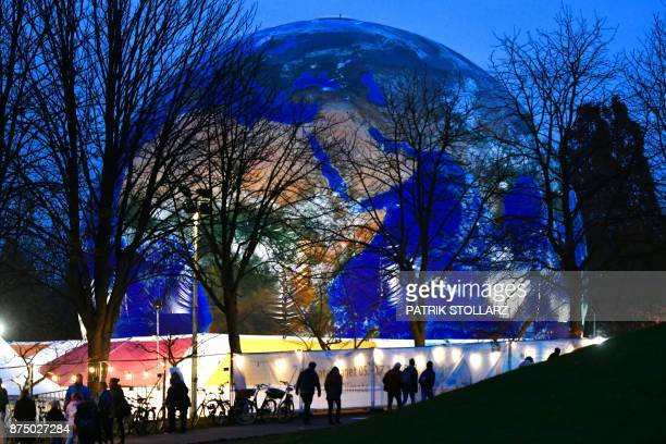A mockup of a planet earth is displayed at the Rheinaue park during the COP23 United Nations Climate Change Conference in Bonn Germany / AFP PHOTO /...